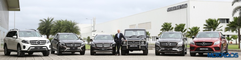 Mr. Roland Folger posing with the entire range of petrol SUVs from Mercedes-Benz