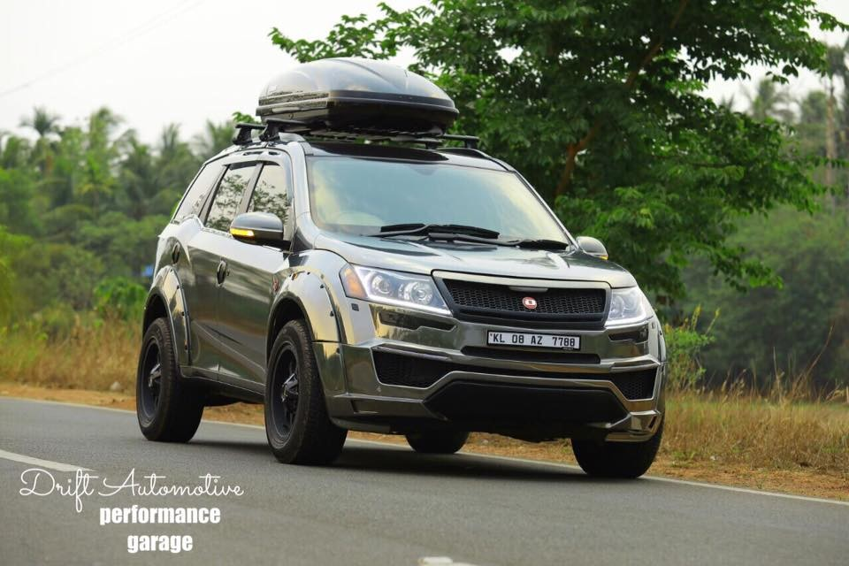 This modified mahindra xuv500 with a chrome black wrap for Xuv 500 exterior modified
