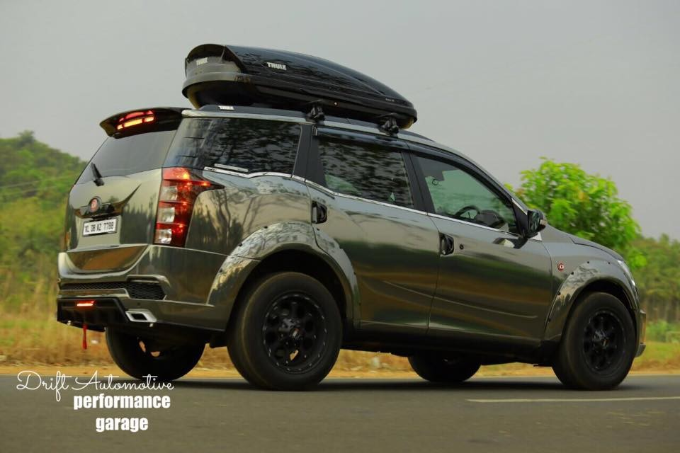 This Modified Mahindra Xuv500 With A Chrome Black Wrap