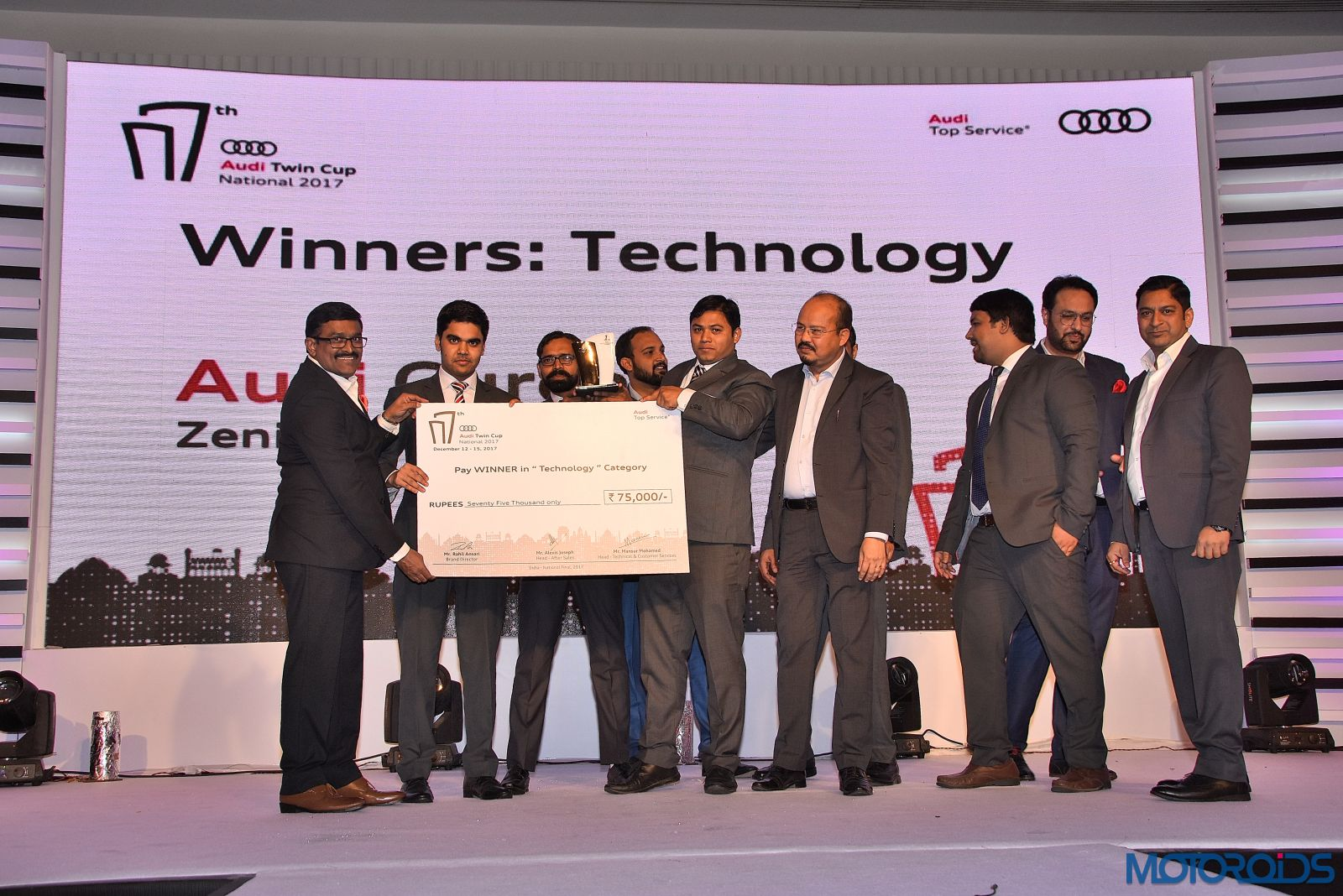 Audi-Gurgaon-winner-in-Technology-Category-receiving-the-Audi-Twin-Cup-trophy-at-the-Seventh-edition-of-the-national-Audi-Twin-Cup