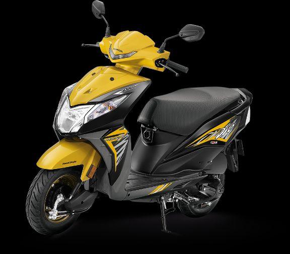 Honda Dio Deluxe Dazzle Yellow Metallic