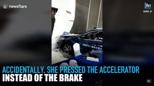 Woman Crashes BMW X1 Into Showroom (2)