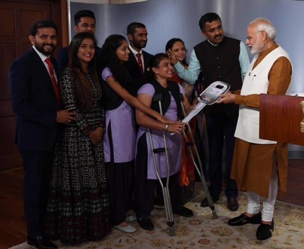 Savji Dholakia gifts cars pm hands car key 1
