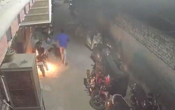 Drunk man sets bike on fire running