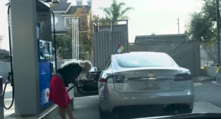 Woman takes Tesla to petrol pump fuel nozzle