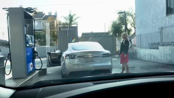Woman takes Tesla to petrol pump standing