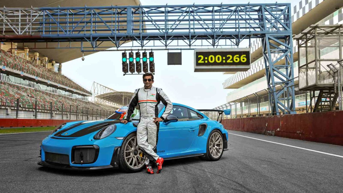 Porsche GT2 RS BIC record holder Narain with lap timer