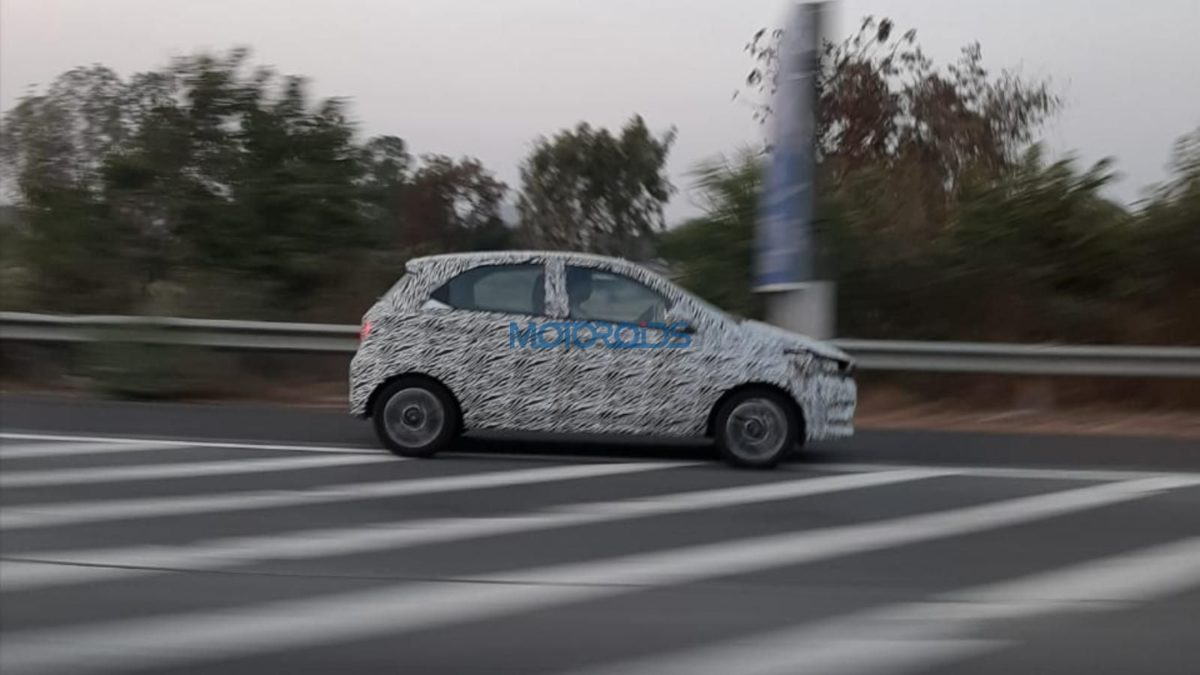 Tata Tiago facelift spied side profile rolling