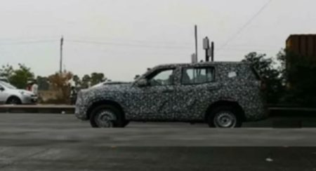 Next Generation Mahindra Scorpio spied side