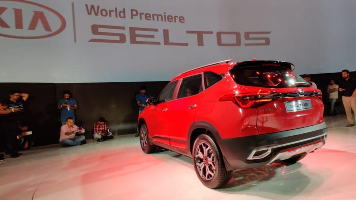 Kia Seltos Unveiled red rear quarter