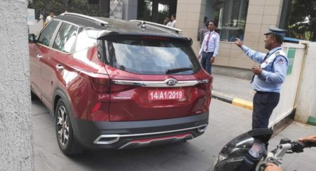 Kia Seltos red and Black rear quarter