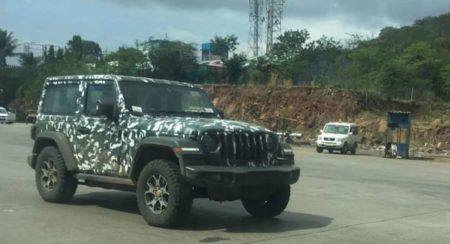 Jeep Wrangler Next gen spied side quarter green three door