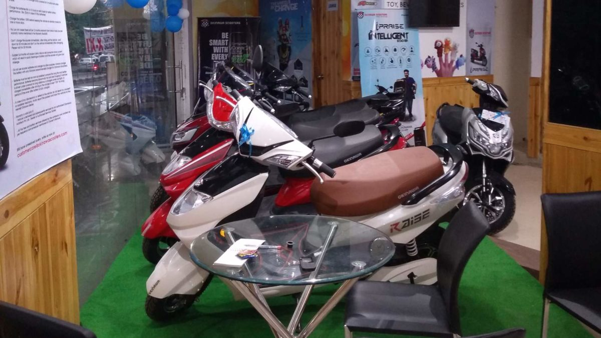 Okinawa dealership in Delhi showroom floor