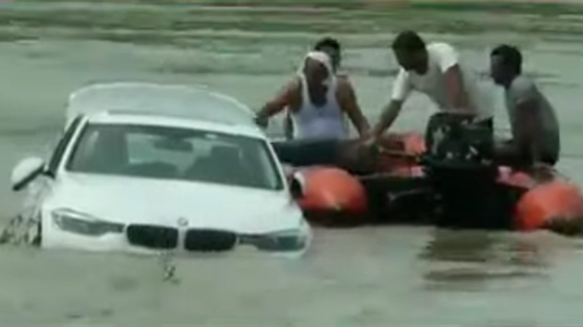 Young man drives his BMW into a river