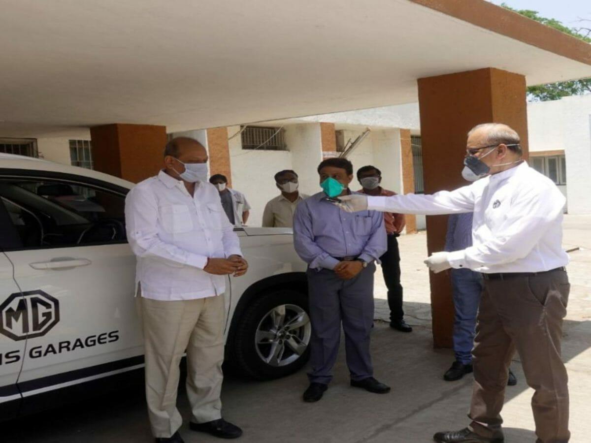 Mr. Jayanta Deb Chief Technical Officer of MG Motor India (right) donates the HECTOR AMBULANCE VERSION to Hon'ble Minister Shri Jaydrathsinhji Parmar